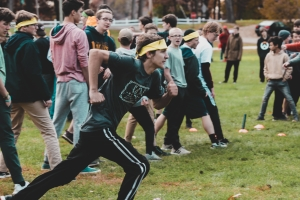 A student from 707 running during a field game