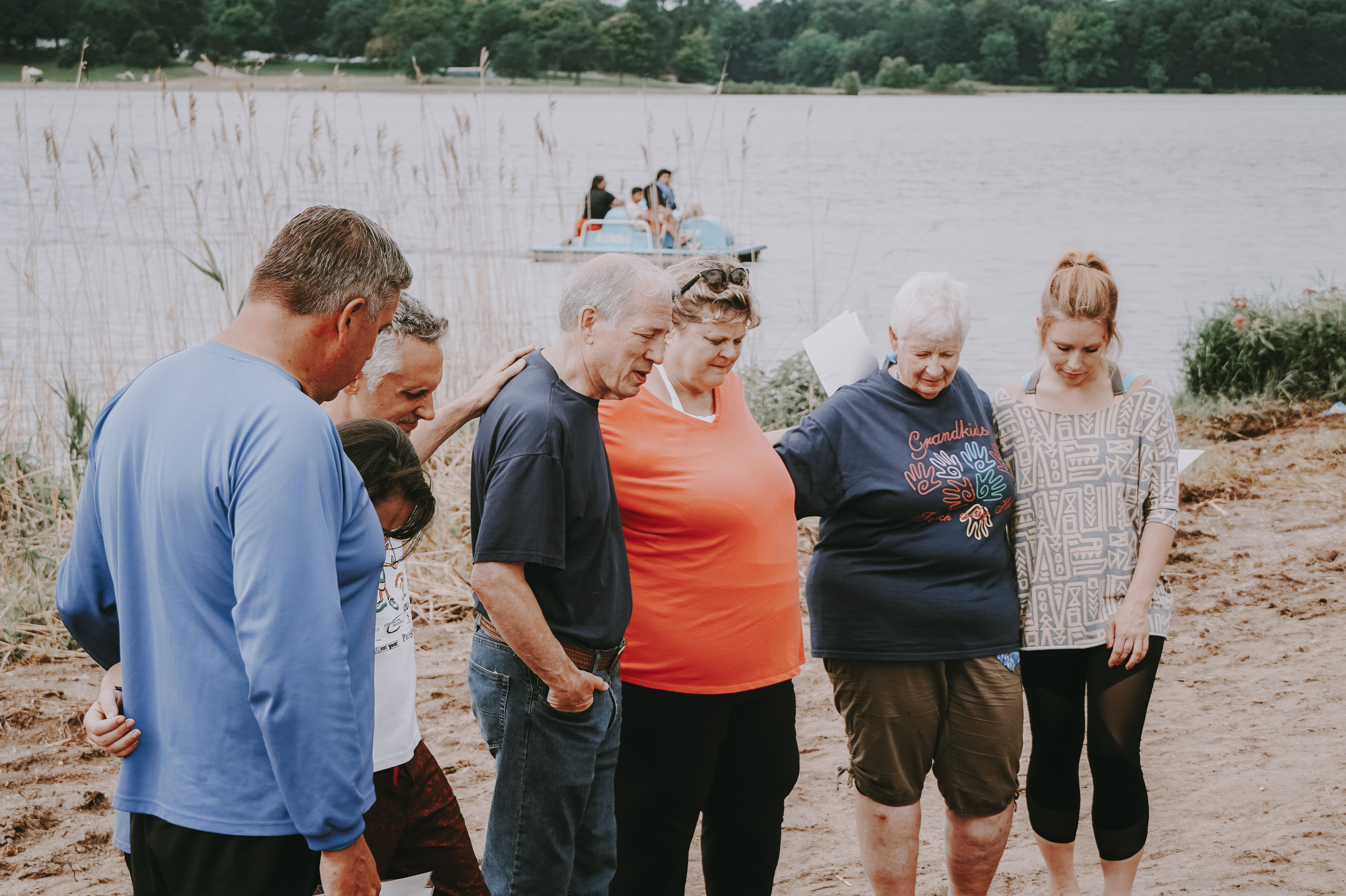 Members of the church praying before a baptism