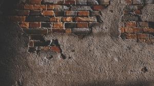 A dark red brick wall.