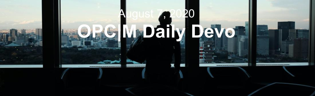 """The outline of a person against a window showing a city skyline with the text, """"August 7, 2020. OPCM Daily Devo."""""""