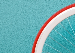 A blue background with a white and red wheel.