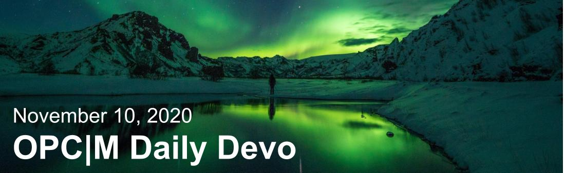 """Green aurora borealis reflected onto water with the text, """"November 10, 2020. OPCM daily devo."""""""