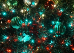 A Christmas tree with red and blue lights.