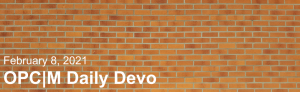 """A brick wall with the text, """"February 8, 2021. OPCM daily devo."""""""