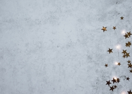 A gray background with cutout stars.