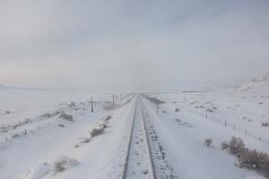 Train tracks in the snow.