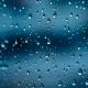 Rain on dark blue glass.