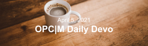 """A cup of coffee on a wooden table with the text, """"April 5, 2021. OPCM daily devo."""""""
