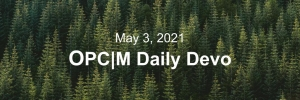 "A birds-eye view of pinetrees with the text, ""May 3, 2021. OPCM daily devo."""