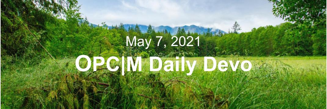 """A grassy field with trees around the edge and the text, """"May 7, 2021. OPCM daily devo."""""""