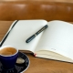A coffee cup and journal.