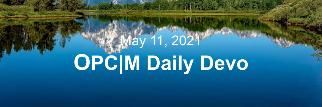 """A lake reflecting mountains and the text, """"may 11, 2021. OPCM daily devo."""""""