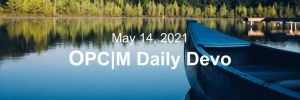 """A canoe on a lake with the text, """"May 14, 2021. OPCM daily devo."""""""