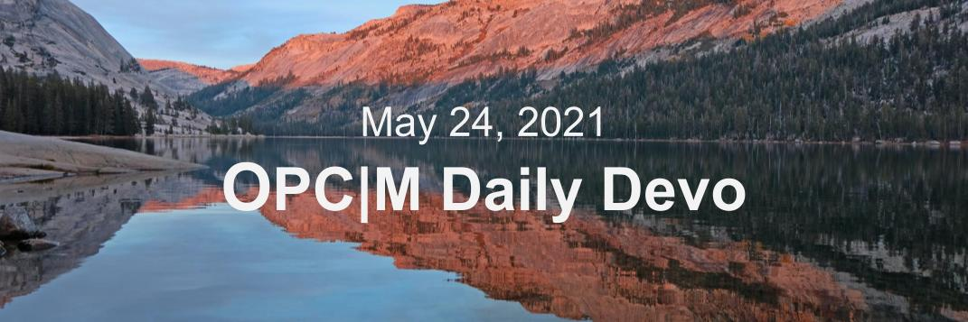 May 24th daily devo image, a lake with orange mountains in the background.
