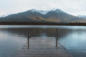 May 10th daily devo image, a lake with mountains in the background.